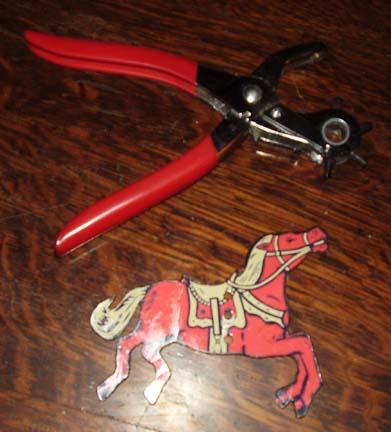 Punch holes in Erector Set horse cutouts