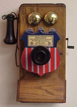 Independent (shield) payphone collector on a Stromberg Carlson Phone