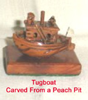 Tugboat carved from a peach pit - Ricks Grandfather