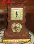 United Metal Goods Swingset Clock