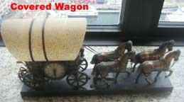 United Metal Goods Covered Wagon Clock