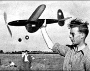 Roy Chesterton, winner of the   Wakefield Rubber powered model airplane contest in 1948 holding jaguar his winning model