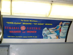 GE Ironer Subway Card Advertisement